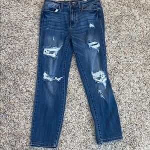 Ripped blue jeans.